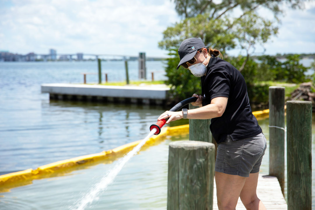Mote researchers attempt a red tide mitigation effort called clay flocculation in Sarasota on Friday, July 16.