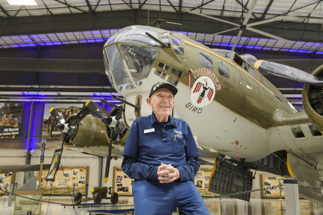 Robert Wehnert, a top-gunner in World War II, sits in front of a B-17G Flying Fortress at the Lone Star Flight Museum.