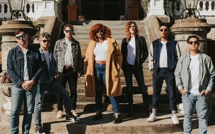Local band The Suffers pose for a photo.