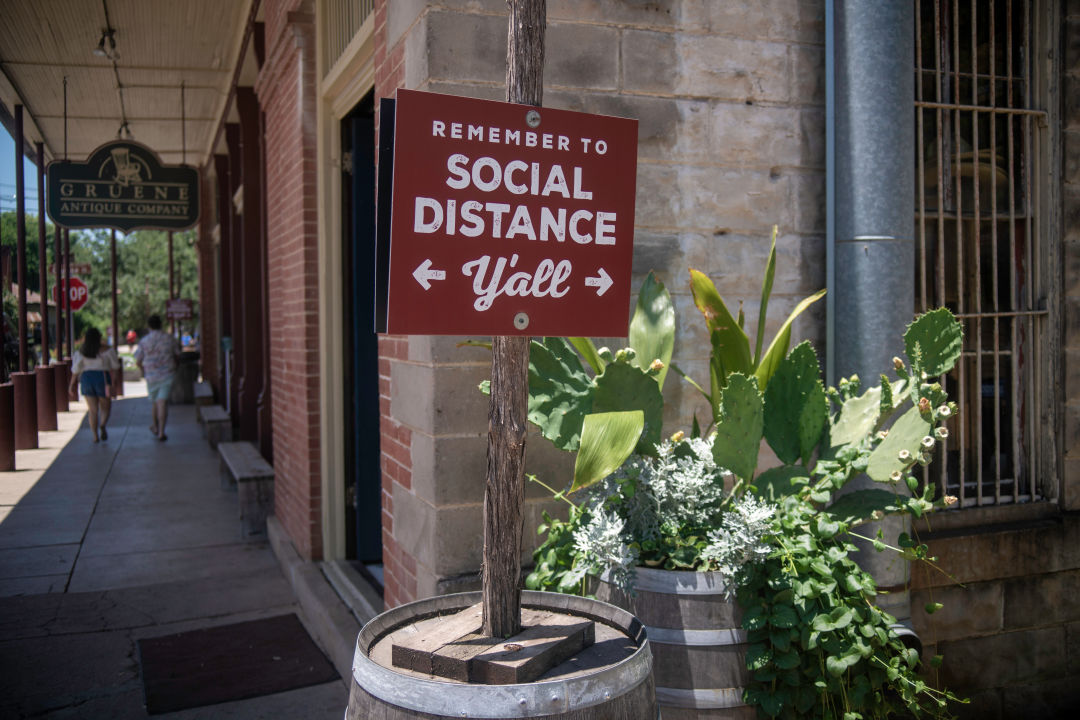 A photo of a social distancing sign