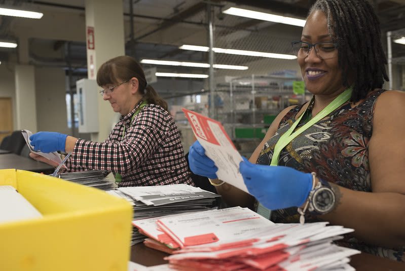 King County Elections employees process ballots.