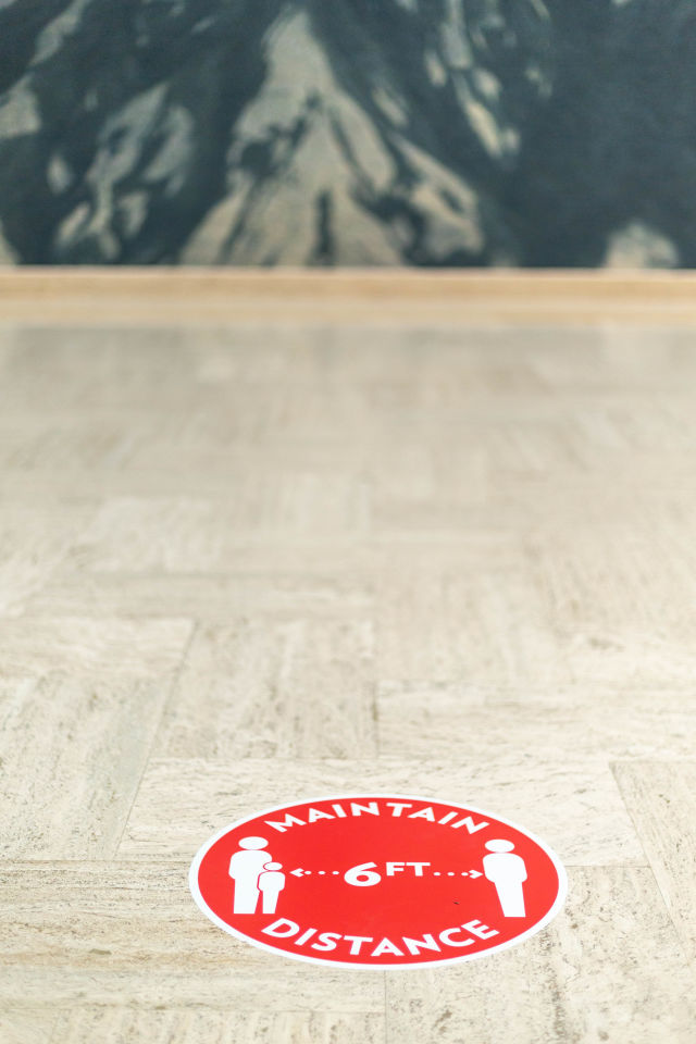 Sticker on the floor of the Portland Art Museum directs visitors to maintain a 6-foot distance from others