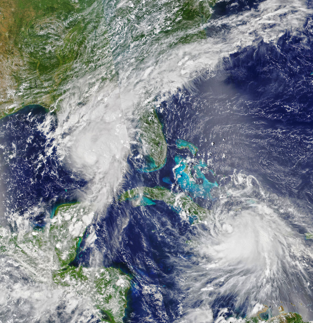 Tropical Storm Marco, at top, and Tropical Storm Laura, at bottom.