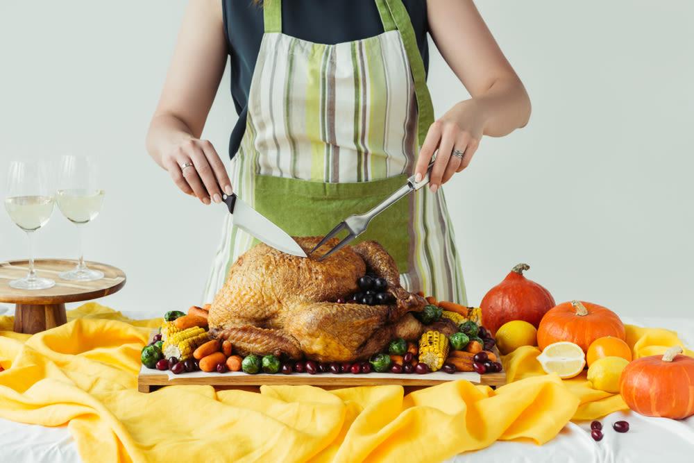 Someone cutting a Thanksgiving turkey