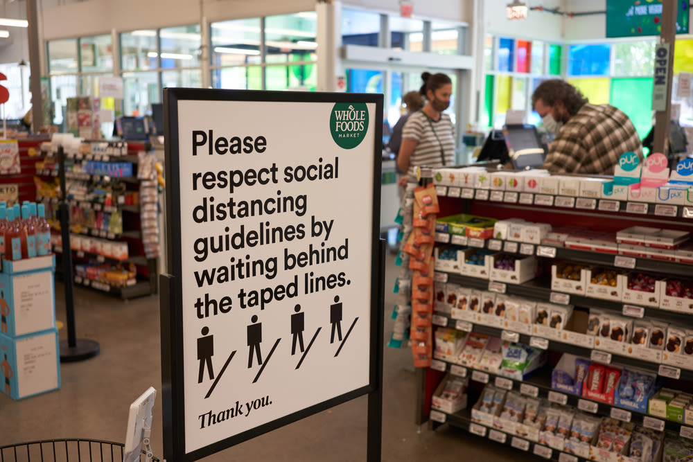 Social distancing sign at Whole Foods
