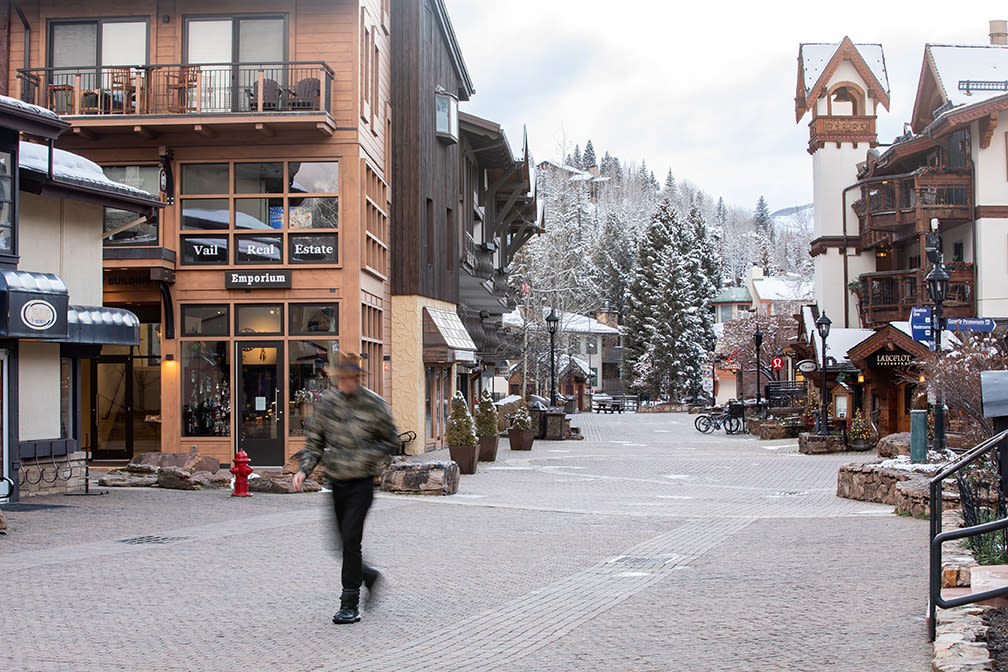 A long pedestrian walks through Vail Village