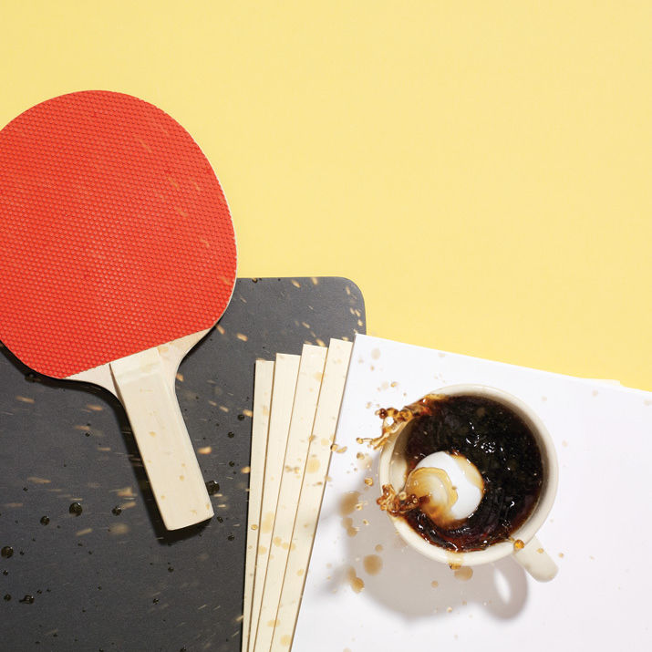 Coffee and ping pong on desk djtyij