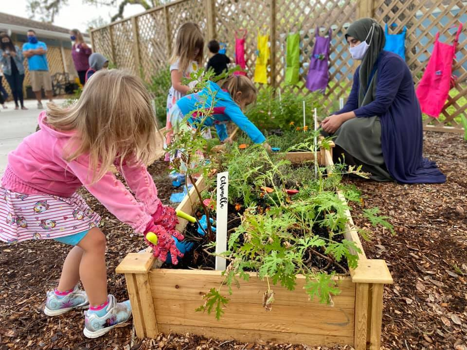 A child plays in The Florida Center for Early Childhood Education's new sensory garden.