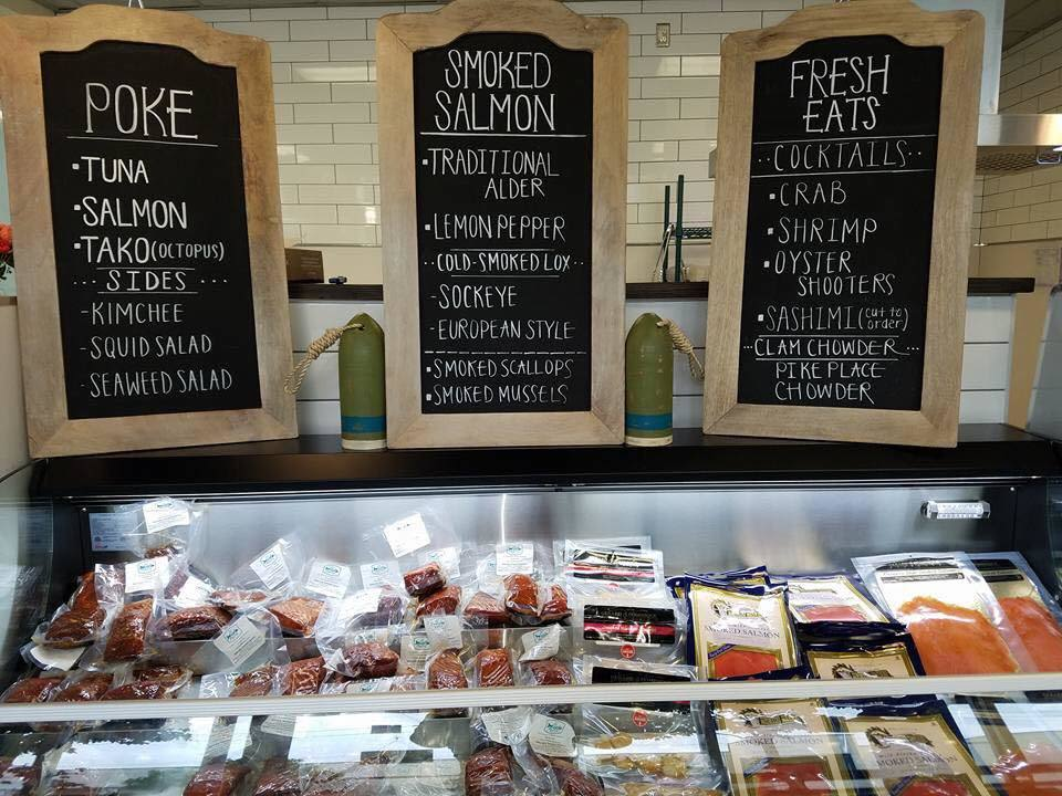 New seafood market and raw bar opens in the central for Fish market seattle