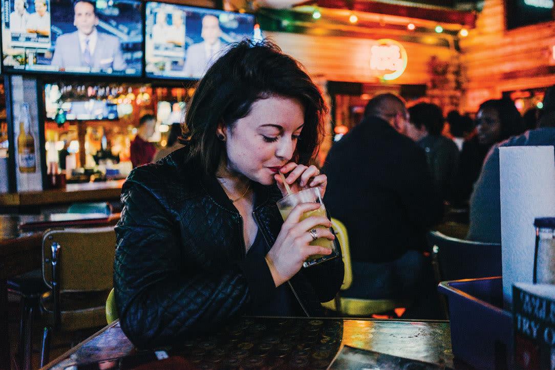 0216 best bars galleria uptown sams boat woman sipping y4rk2b