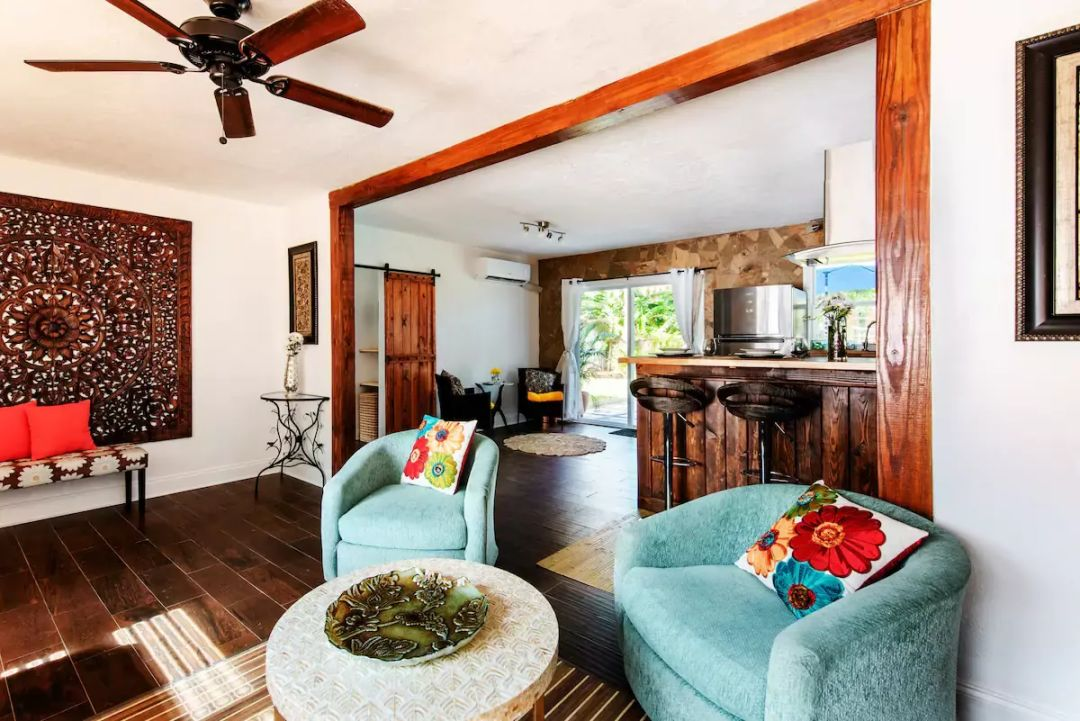 Dark wood floors and details with pops of bold color make Casa Azul fun and bright.