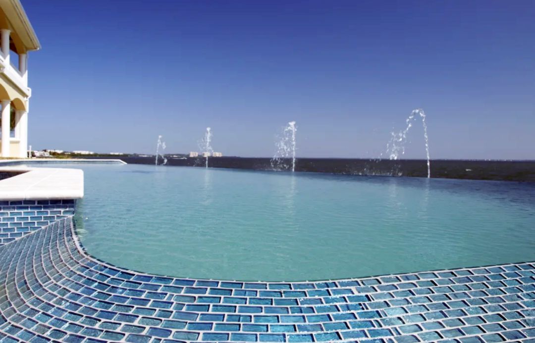 A custom pool from Freestyle Pool & Spa with fountain water features.