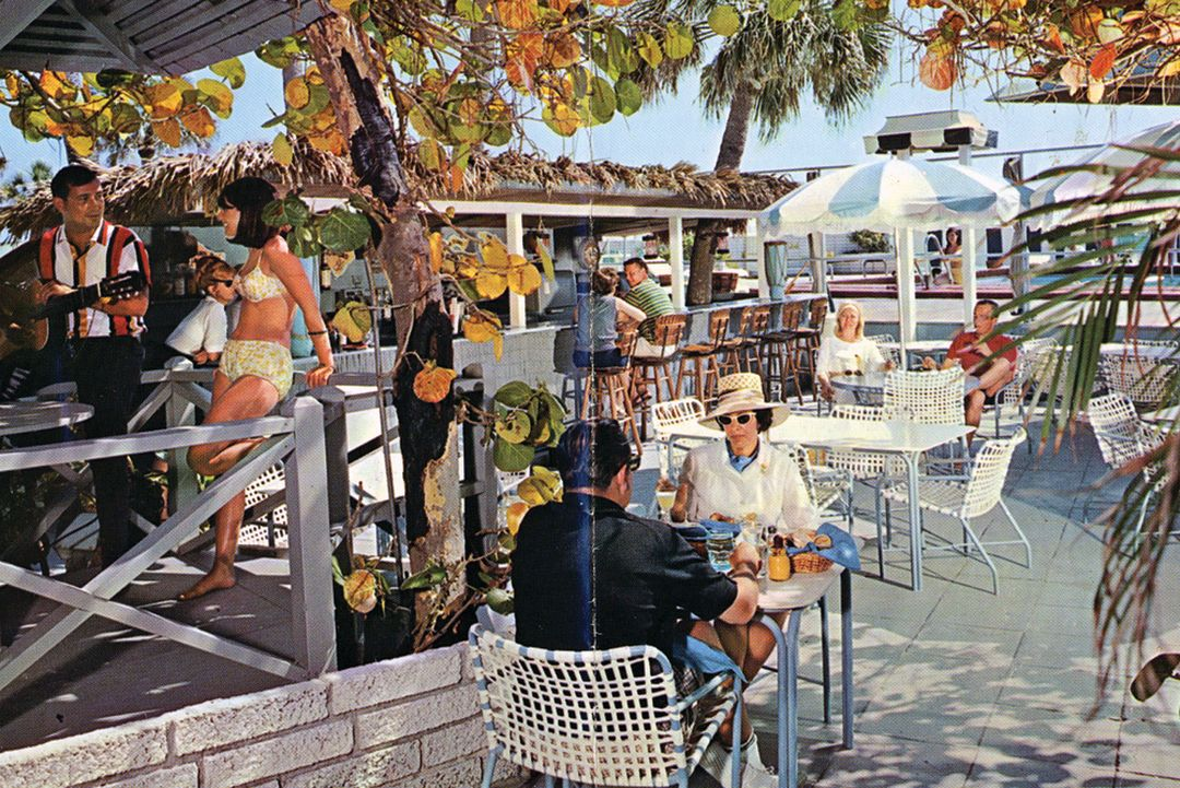 A vintage view of the Colony's tiki bar and pool areas.