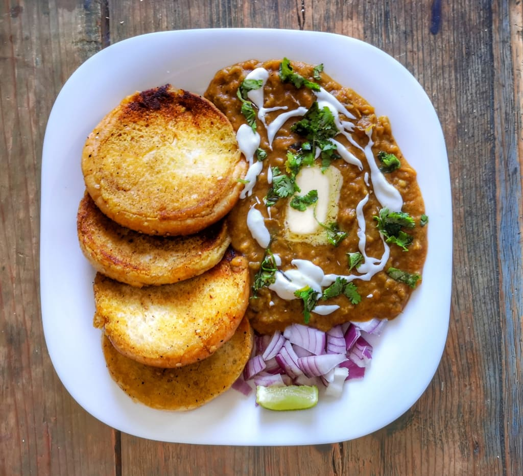Pav Bhaji, an Indian street food with buttery toasted bread called Pav, eaten with spicy mashed vegetables