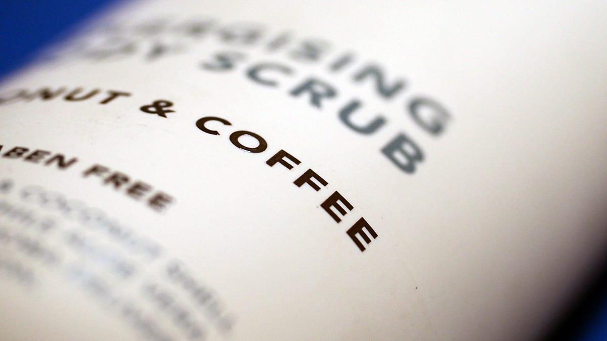 A photo of a cream tube using coffee.