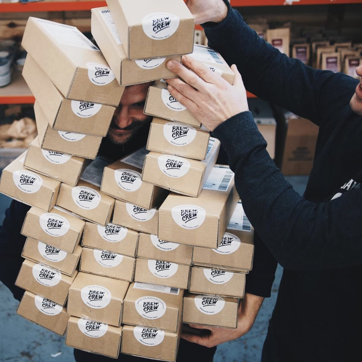 John full of coffee delivery boxes in our warehouse