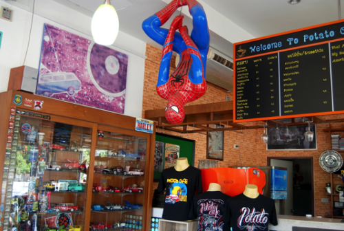 Spiderman just hanging around to take your order.