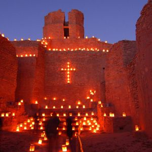 """Thousands of farolitos cast a glow on the gardens, courtyards and adobe walls of the century-old buildings lining the road. Farolitos are little lights made out of paper bags, sand, and tea candles. In Spanish, the word farolito translates as """"little lantern"""" and it is the preferred term in Santa Fe for the decorations that are referred to as luminarias elsewhere.Both spirit and senses will be enriched by the aroma of piñon logs burning in small bonfires (luminarias) and the sounds of street musicians playing traditional holiday songs. The sweet taste of hot chocolate, warm biscochitos, and luminarias along the road take the chill out of the crisp mountain air.Many businesses are closed on Christmas Eve, however, others remain open for last-minute shoppers and offer a place to warm up. Be sure to dress warmly, and bring the whole family to this festive holiday event."""