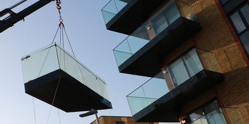 rapid install of preassembled cassettes using hiab truck to glide-on balconies