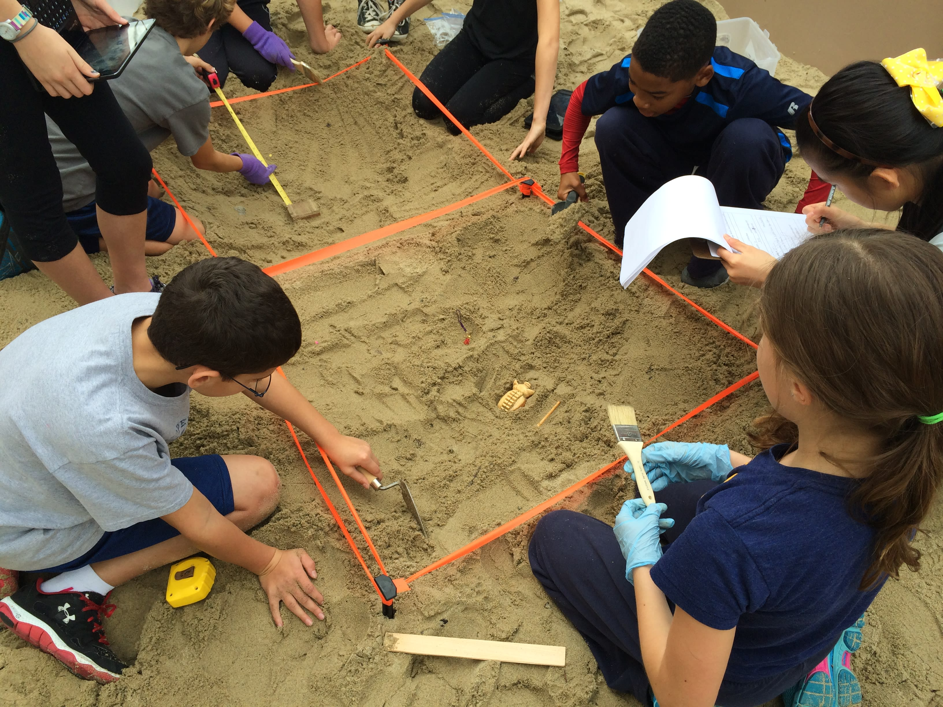 Children participate in an archaeological dig activity