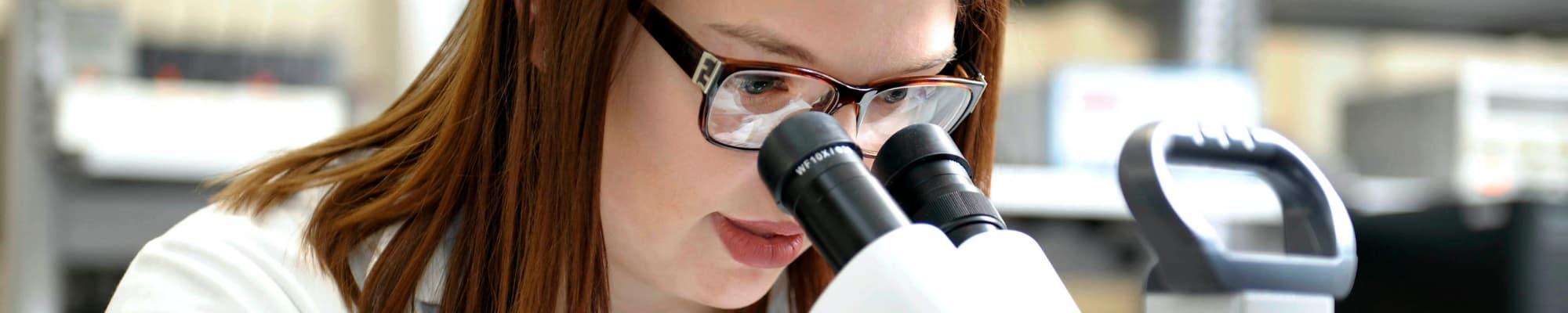 Image of student using microscope