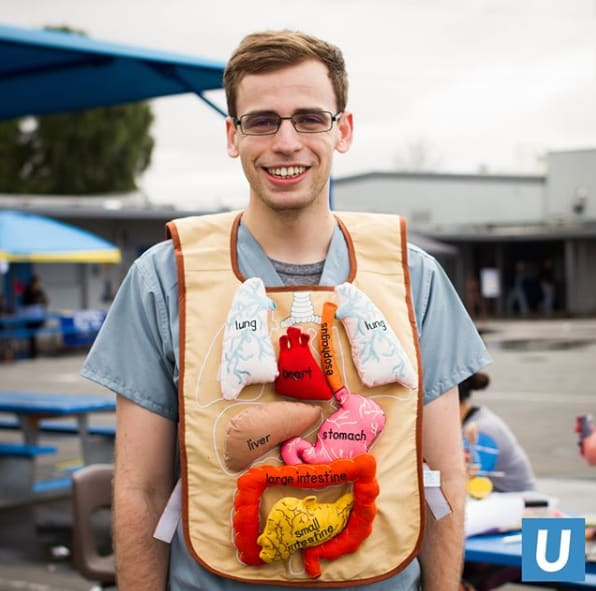 Headshot of Vadim Osadchiy, medical student, wearing an anatomy bib with felt organs