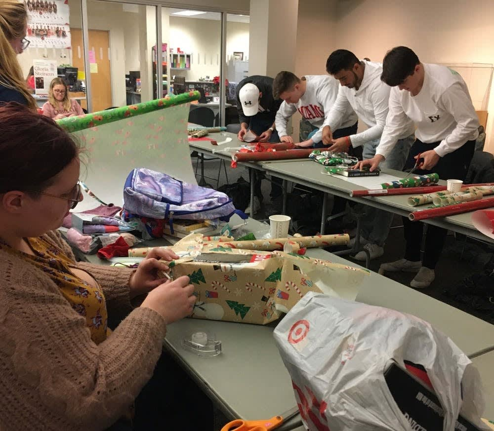 <p>Students help wrap donated gifts for Ball State's Student Voluntary Services' annual Angel Tree event Dec. 3, 2019. More than 351 children will receive gifts for the holiday season because students, staff and community members volunteered to sponsor them. <strong>Tier Morrow, DN</strong></p>