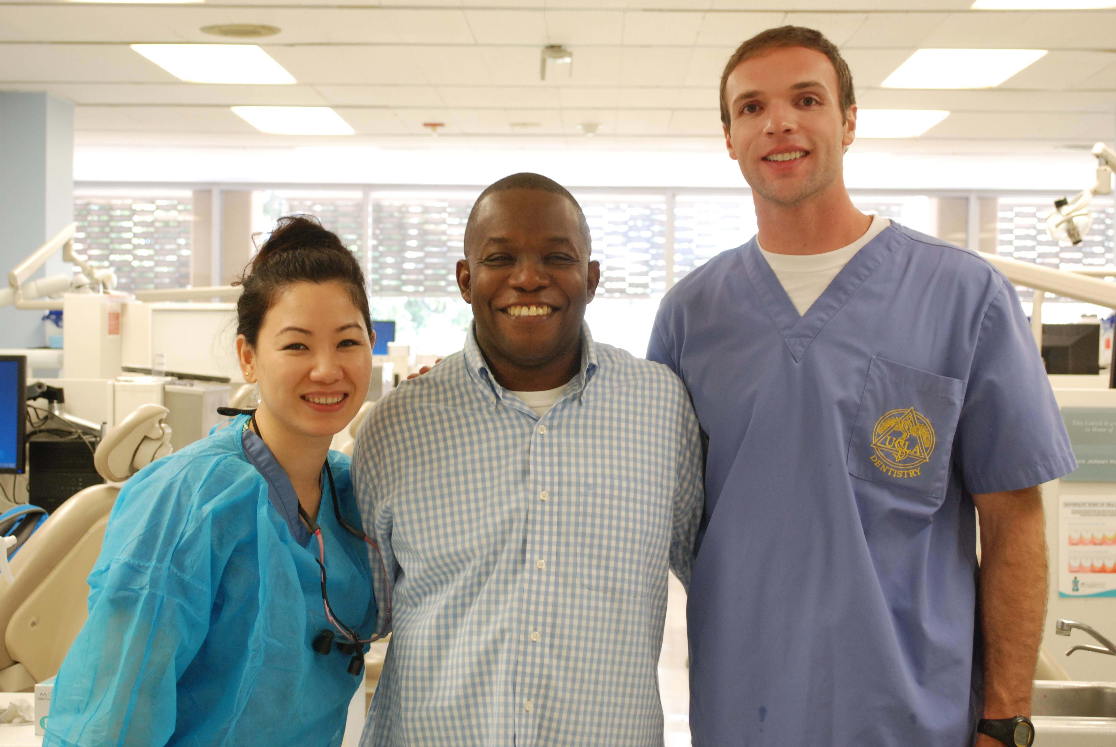 Operation Bruin Smiles patient, UCLA student veteran Rodrick F., shows off his new smile with Co-Founders Tigon Abalos and Brian Lehigh