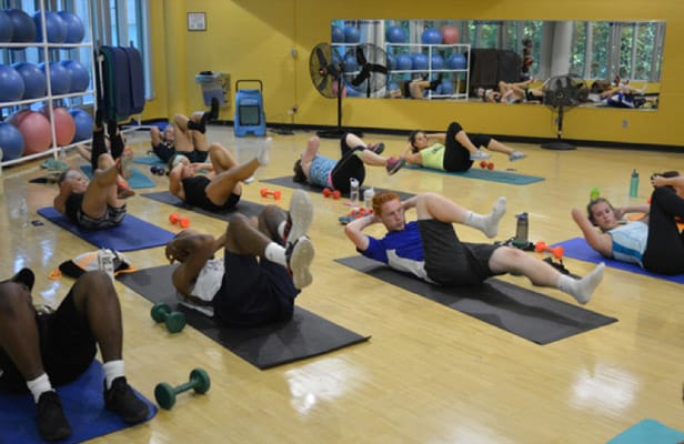 Students participating in an exercise class at the Rec Center