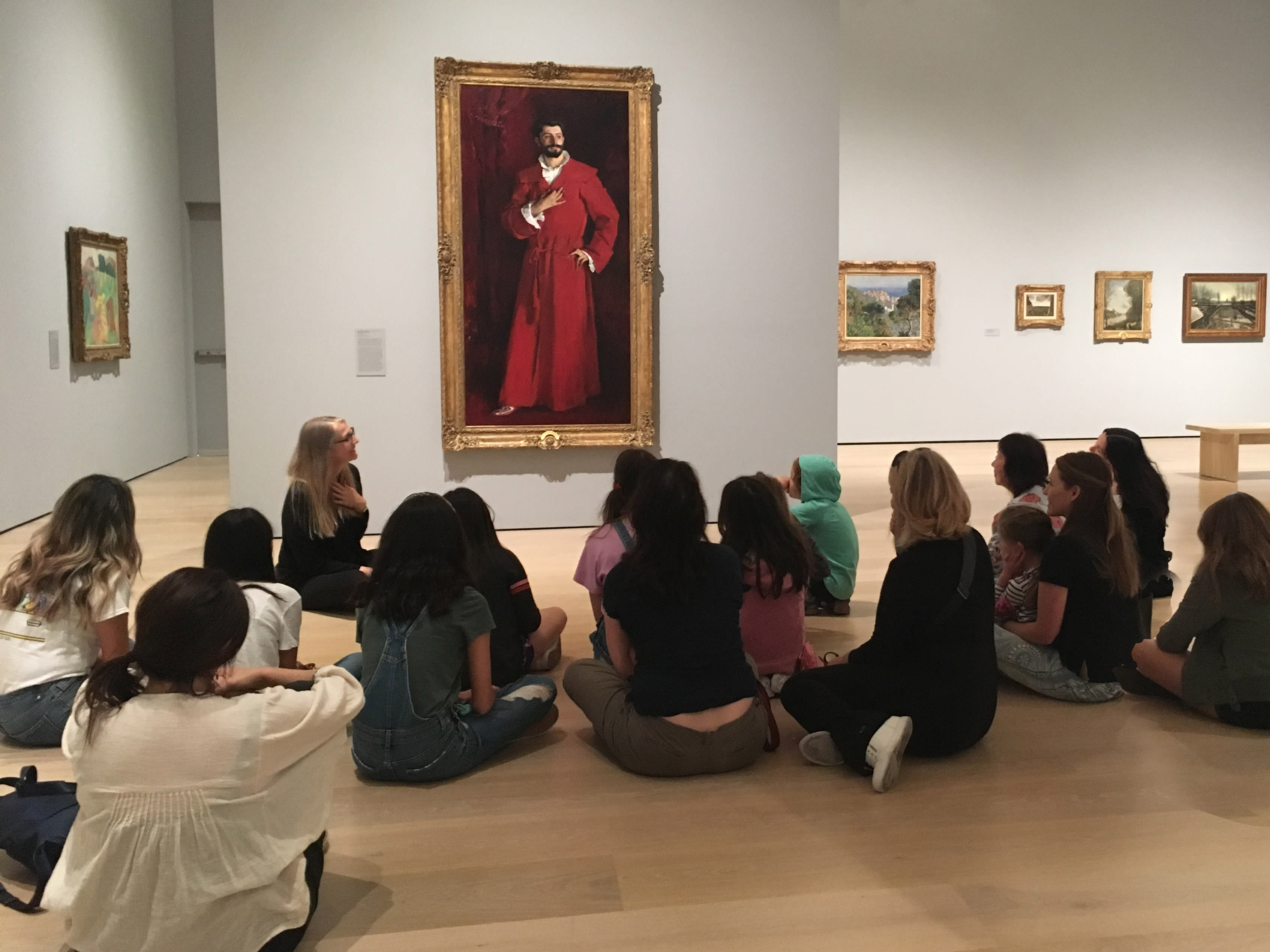 students study a painting