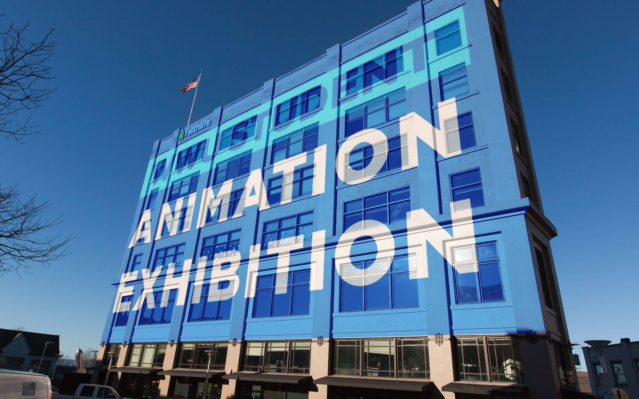 "projection of the words ""Animation Exhibition"" on the side of a 5-story building"