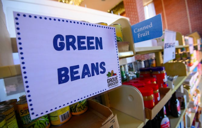 Shelves of Grove Grocery with sign that says green beans
