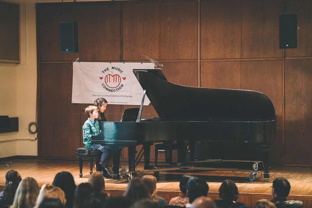 Our tutor performing with her student at our Fall 2018 Private Piano/Vocal Recital.