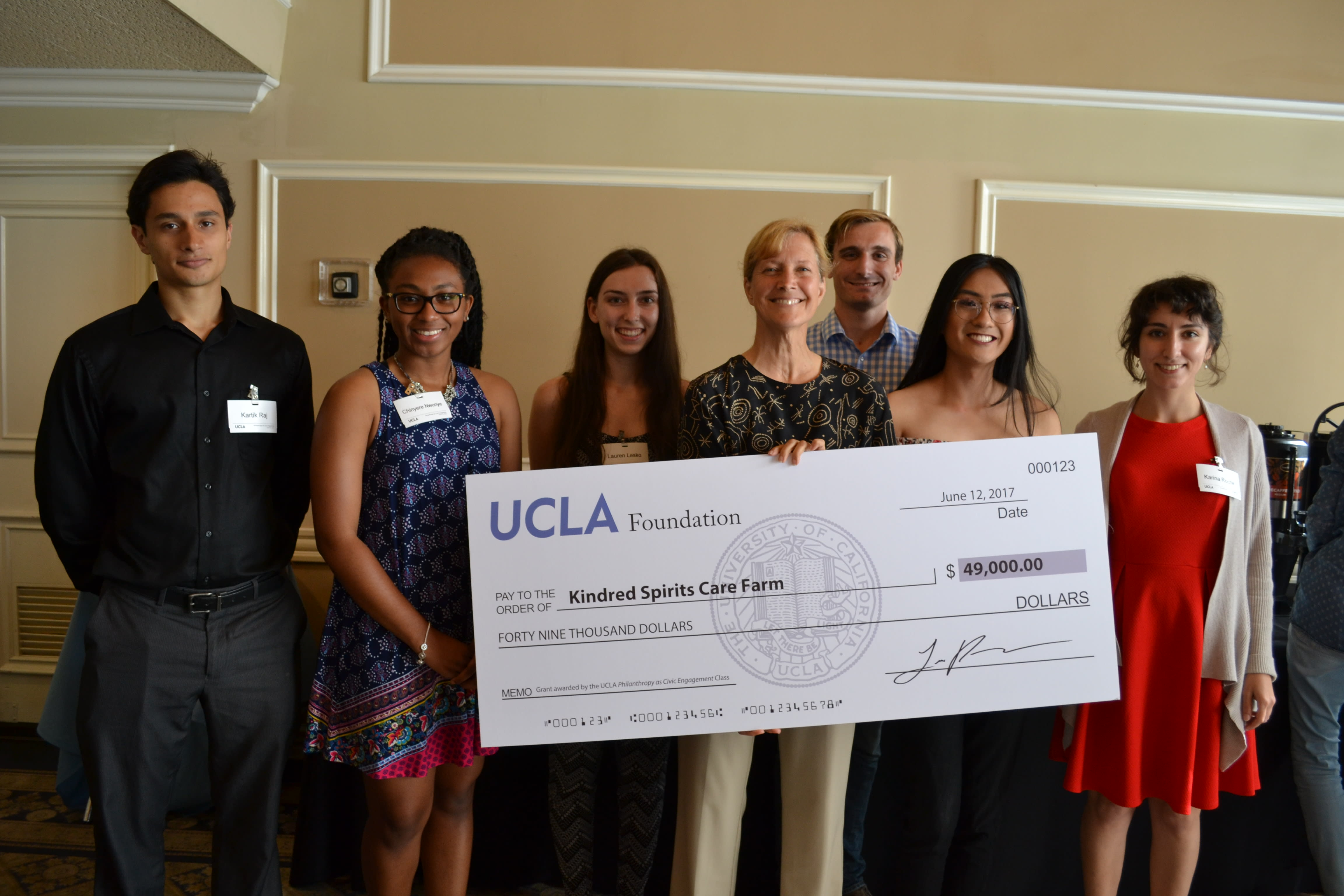UCLA Pace Students presenting a nonprofit with a funding check