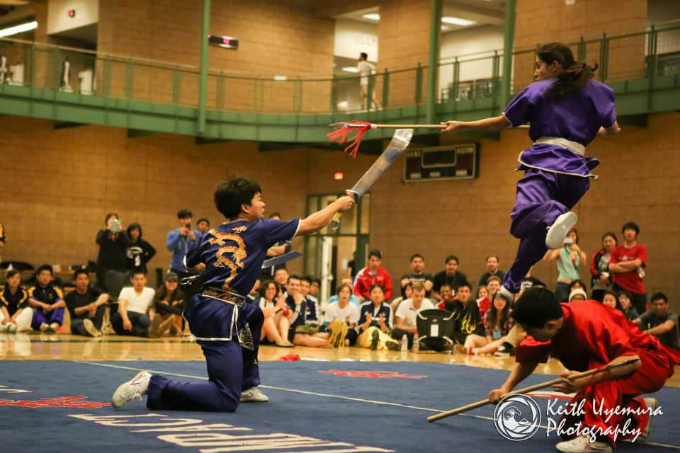 Connor Hum uses his double broadswords to fight off Ariela Feitelberg and Olivia Leu in the 19th Collegiate Wushu Tournament at UC Irvine.