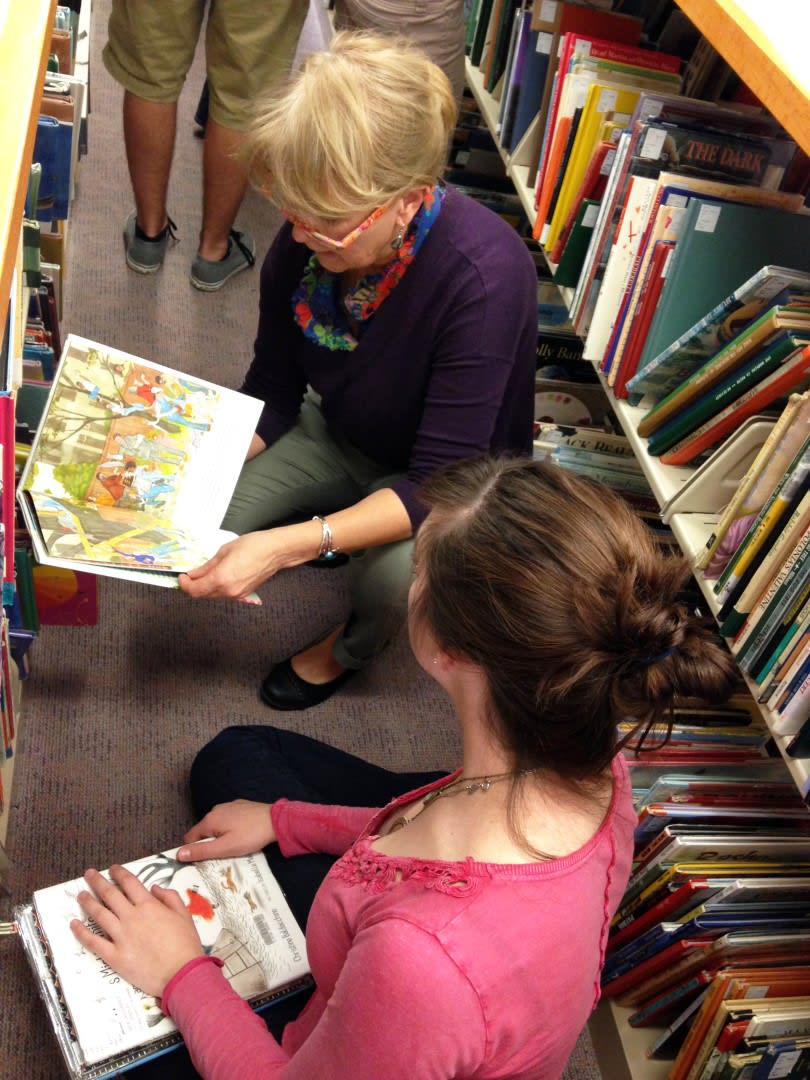 Photo of people looking at children's books at the library