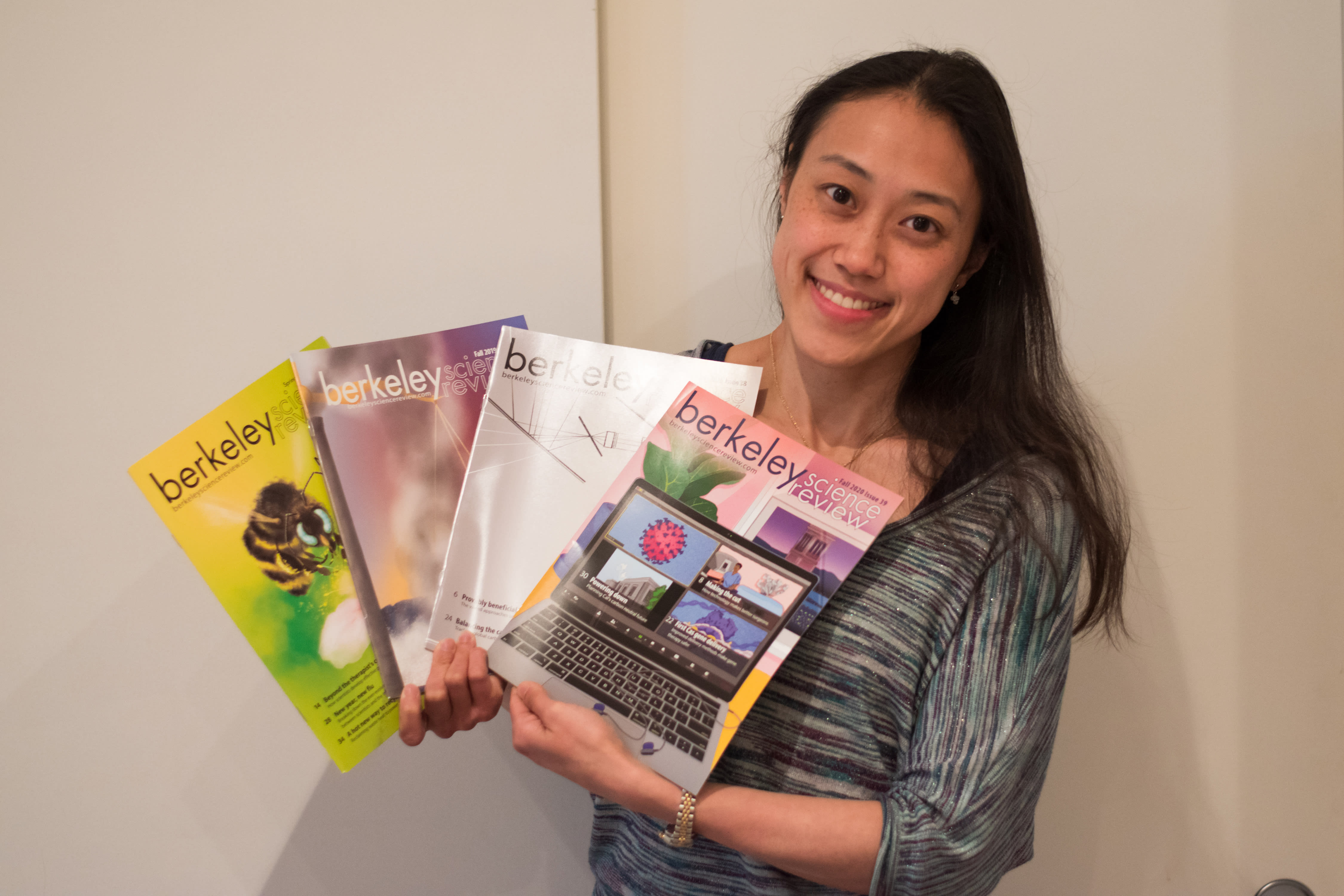Blog editor in chief Maiko holding up BSR magazines