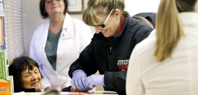 Fresno State students provide free health services to rural communities through the Community Health Mobile Unit.