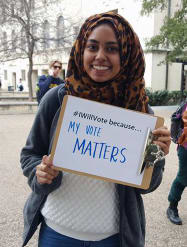 "Girl holding ""My Vote Matters"" Sign"