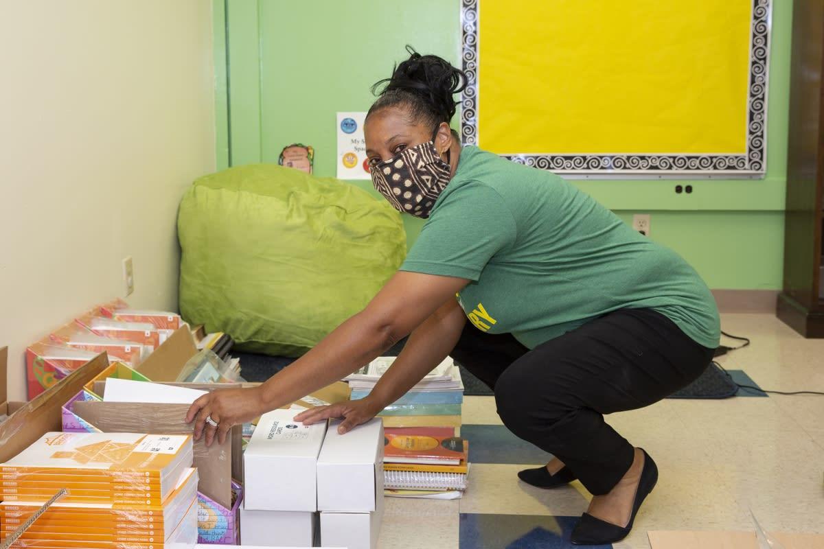 Teacher preparing classroom at Niner University Elementary