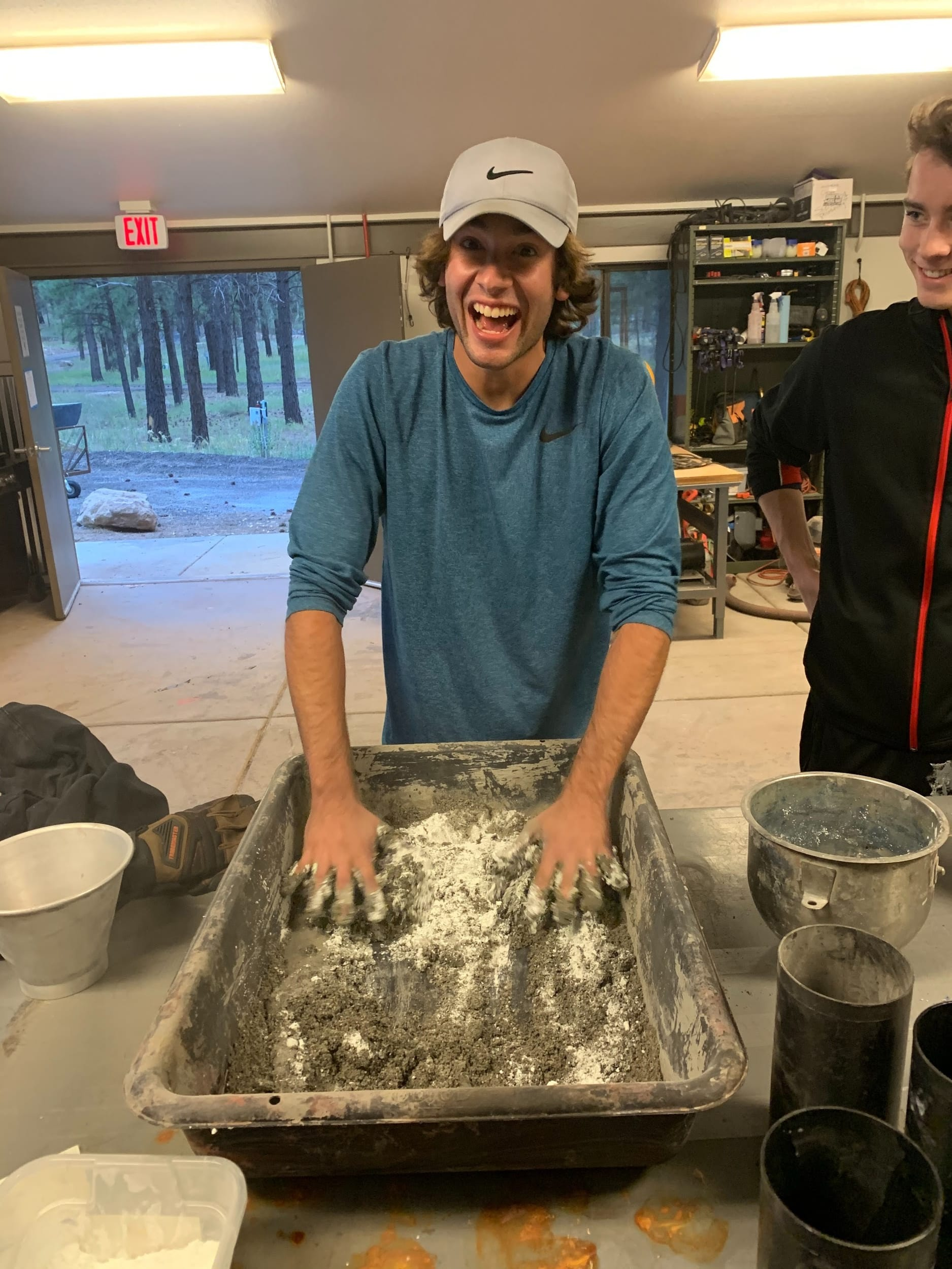 Kyle mixing concrete with his hands