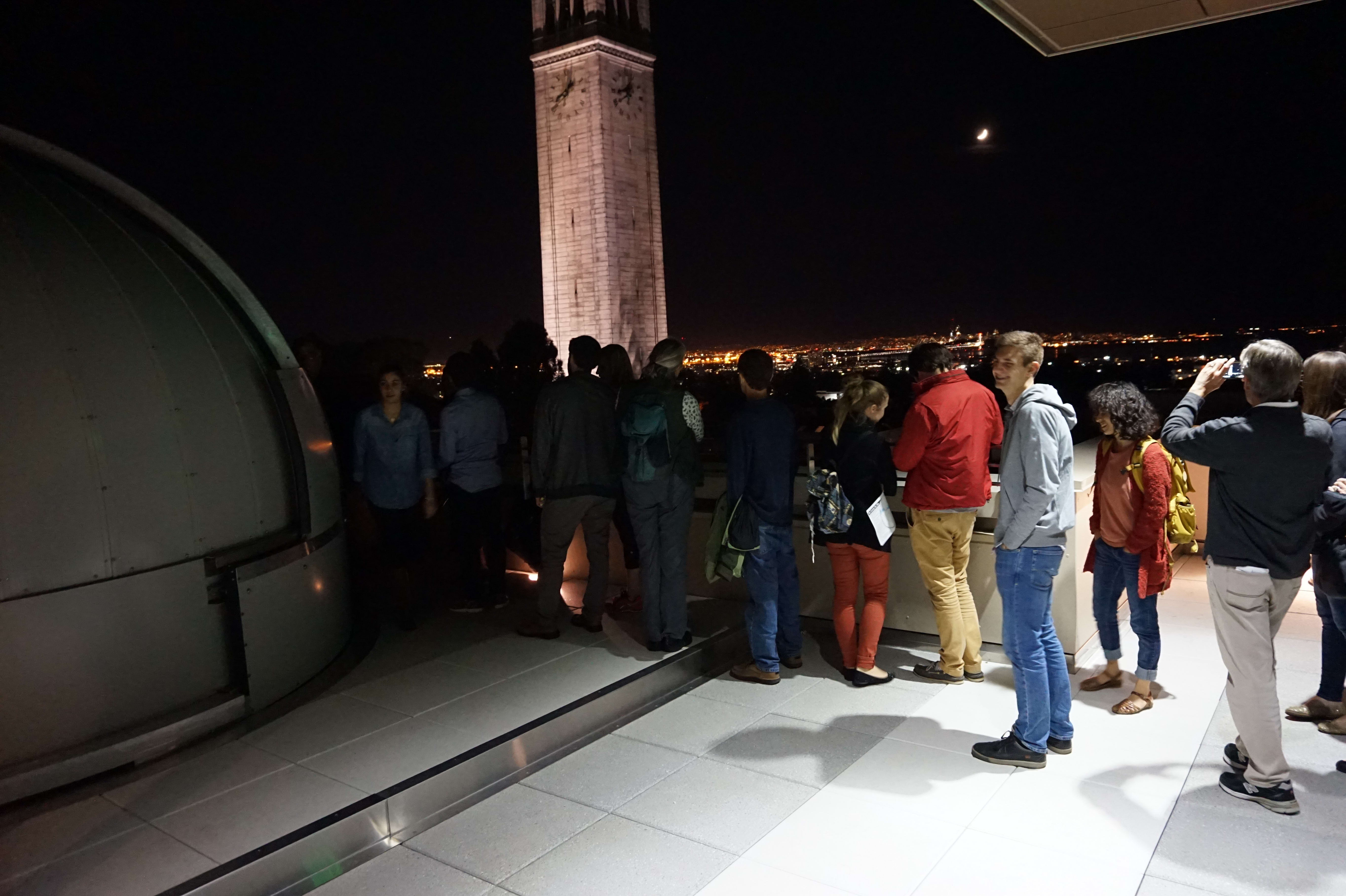 Visitors waiting to stargaze through the Campbell Hall telescope