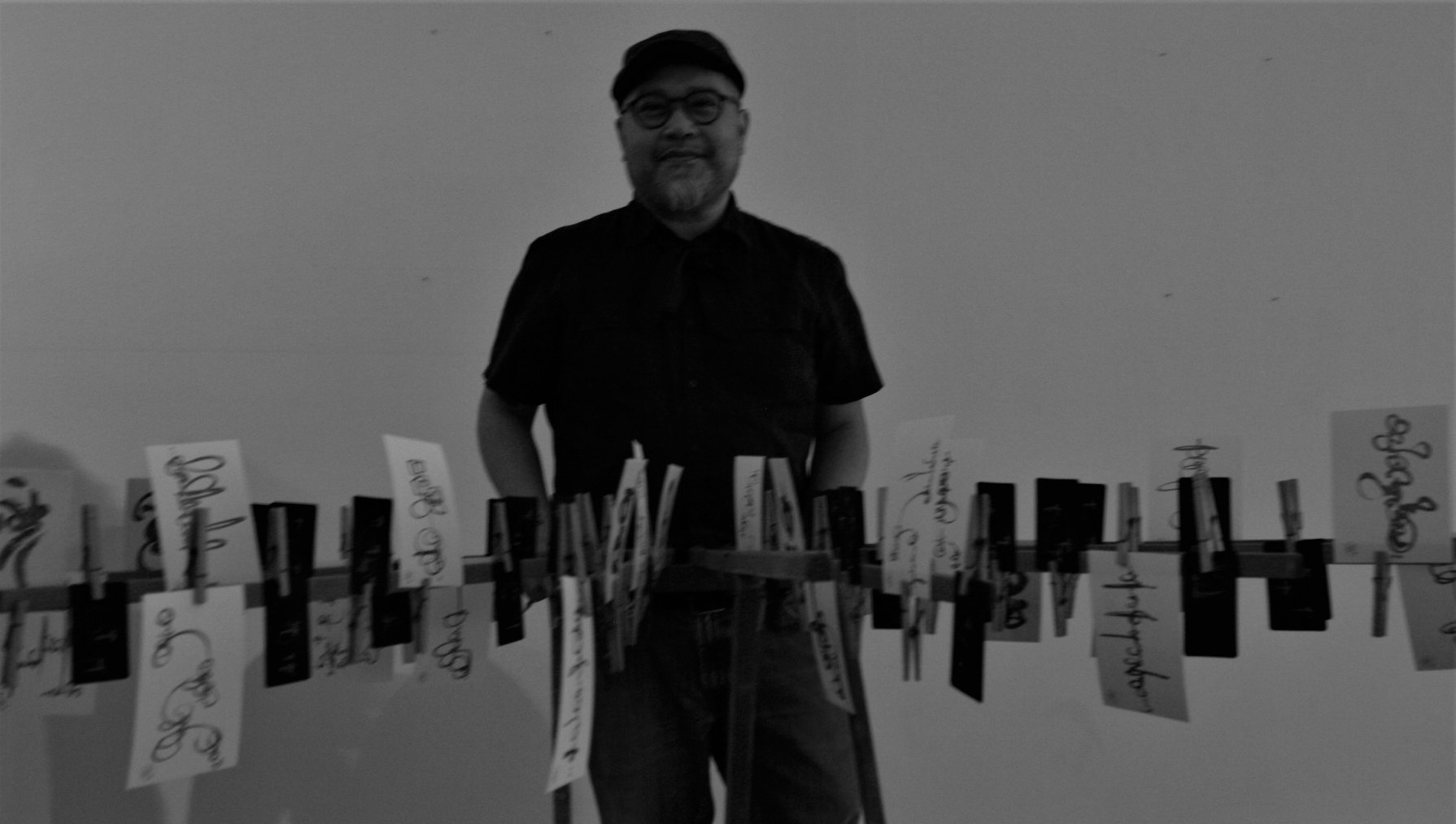 Sam Roxas-Chua poses with a portion of his visual arts exhibit at last year's festival.