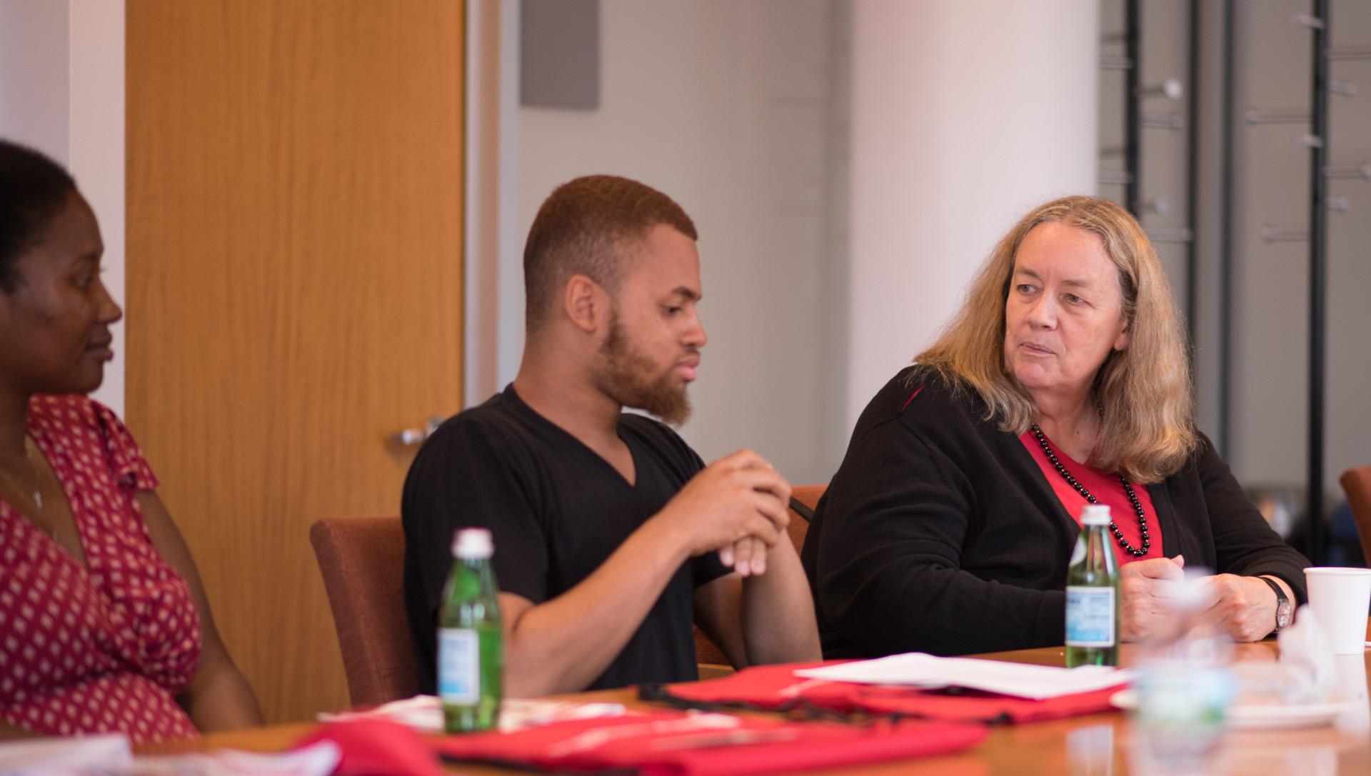 NYU Gallatin Dean Susanne Wofford with GUIDE scholars.