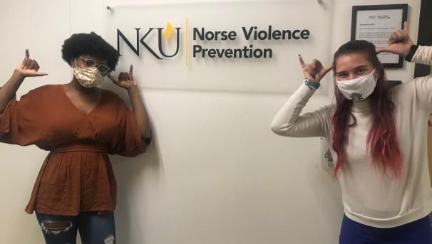 NVP ambassadors standing next to NVP office sign.