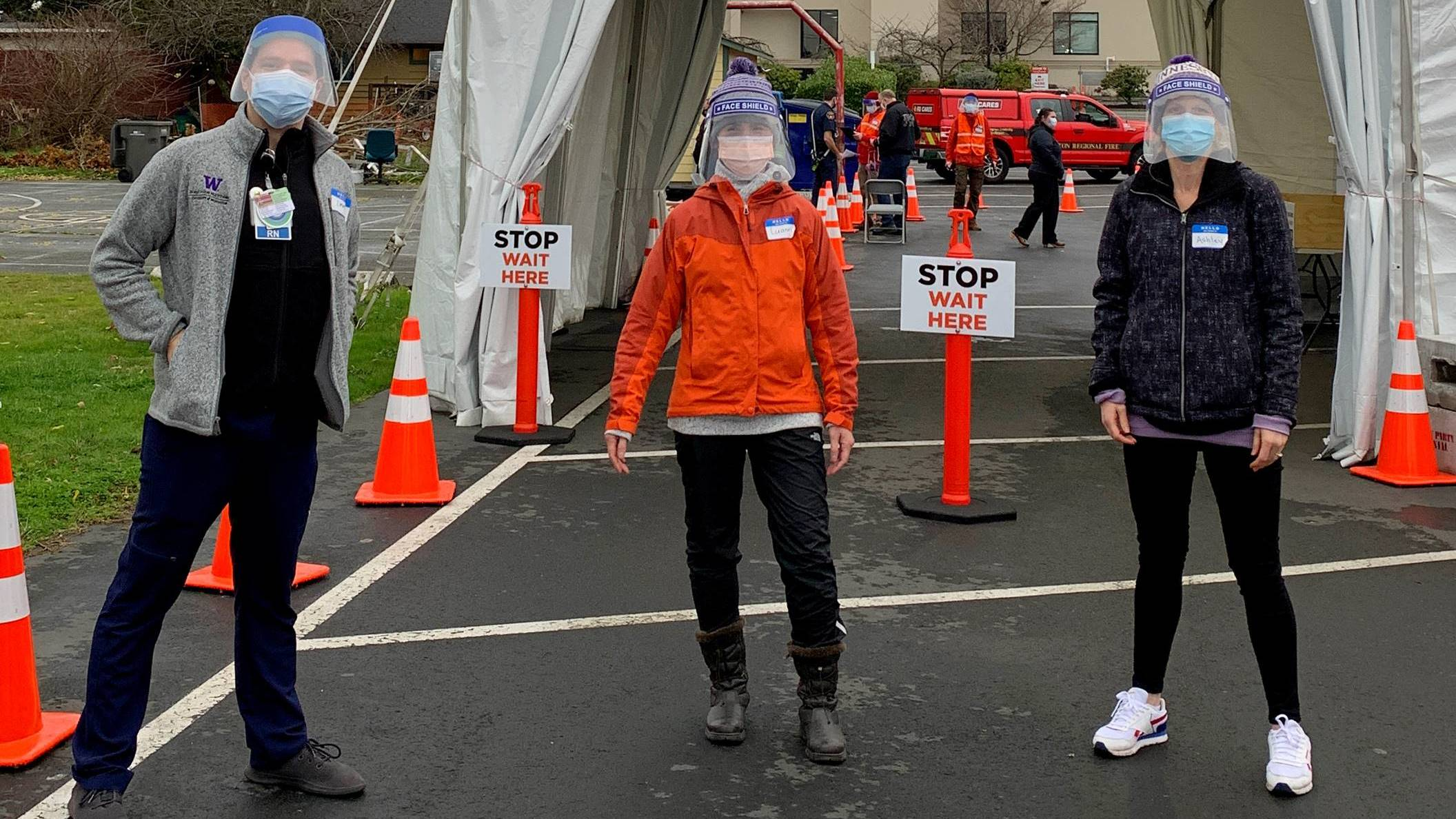 Three UW SChool of Nursing Students wearing face shields and mask at a vaccination site