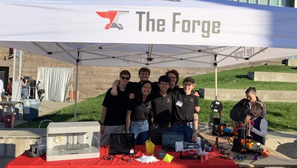Members of The Forge outside showing their projects