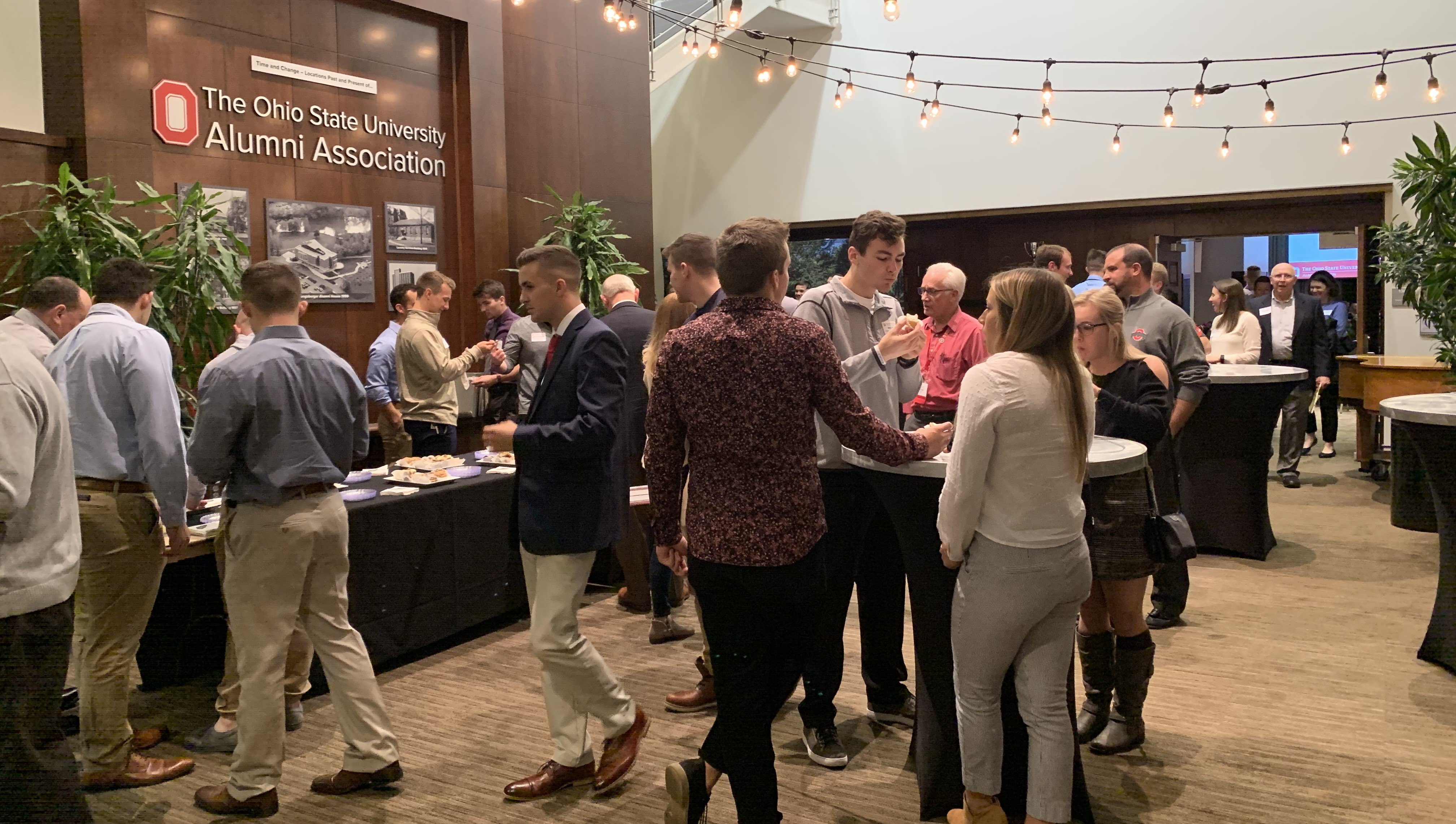 Students and Alumni connecting at one of our signature events: Dinner for 12 Buckeyes.