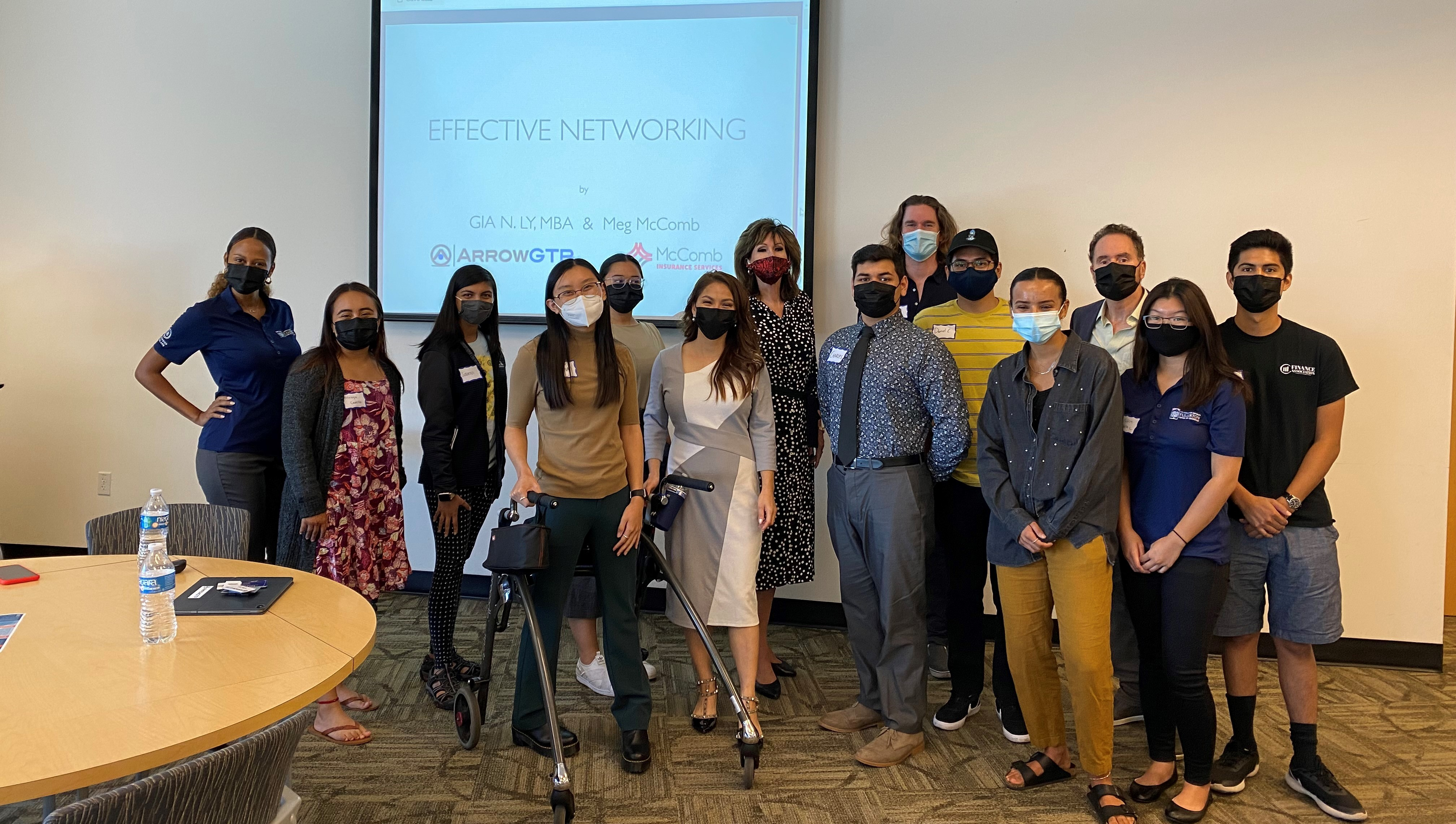 Program students at a networking seminar
