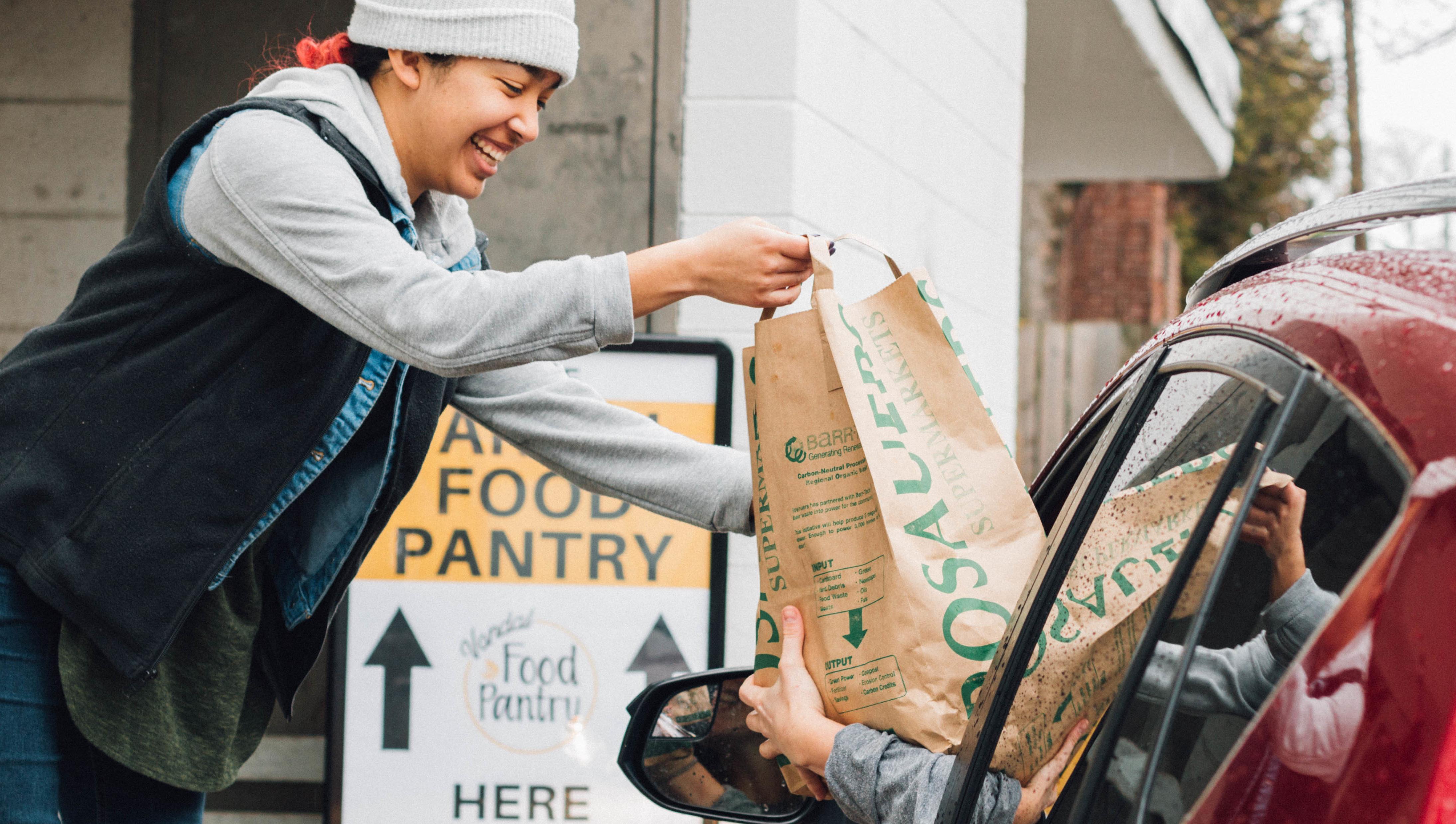 Volunteer Distributing Food